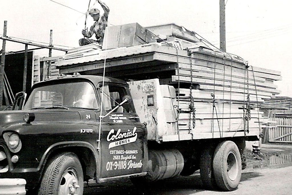 A home materials truck delivery by Colonial Homes in 1953.